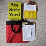 "Door-knocking kit with ""Bee Safe Yard"" signs."